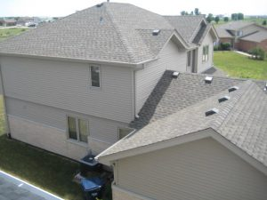 House with grey roof, roofing A plus roofing chicago il
