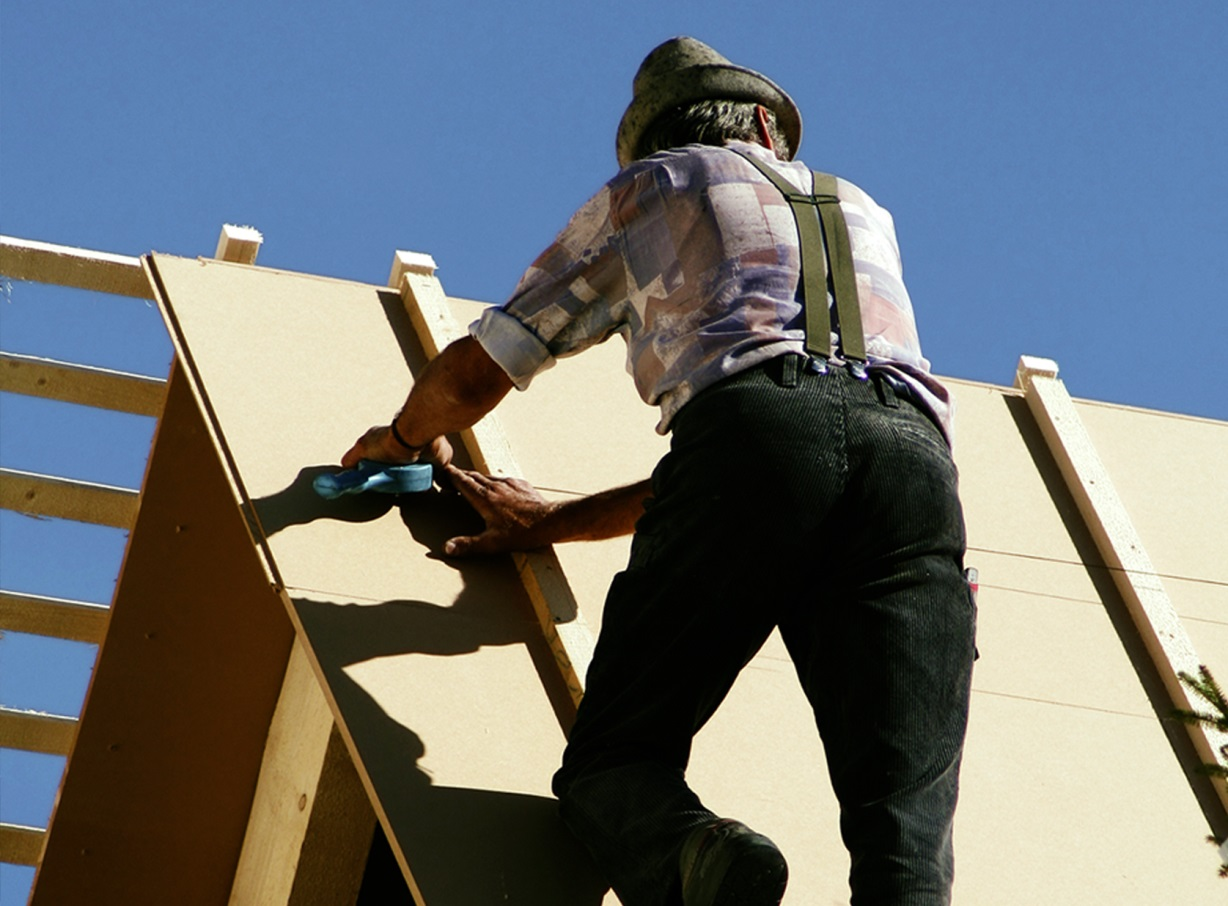 man person building a roof